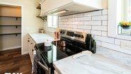 Woodland Series The Adriel WL-7801 Corner ½ Rock Fireplace Kitchen