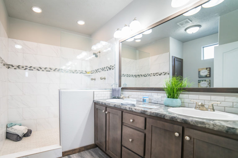 """KIT Decor - 4'x7' walk in tile shower with carrera tile walls and diamond delta mosaic glass accent. 36"""" x 48"""" glass divider panel also shown"""